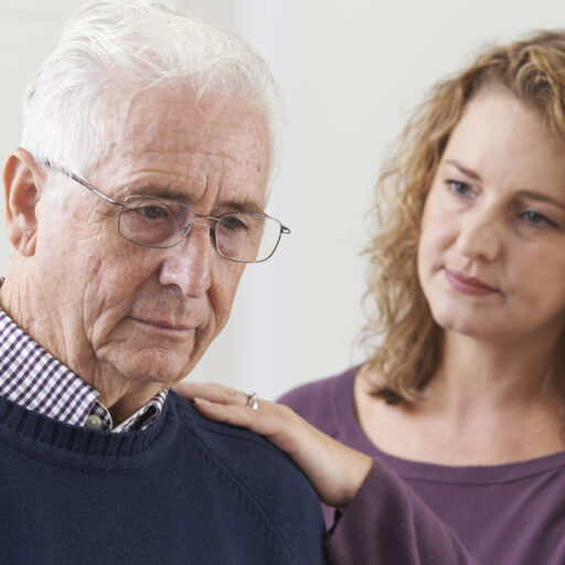 A woman comforts her senior father as he tries to cope with grief during the holidays.