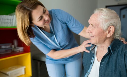 A Geriatric Care Manager works with a senior man.