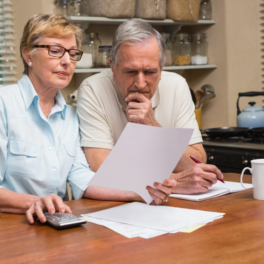 Senior couple looking over their end of life planning for National Healthcare Decision day.