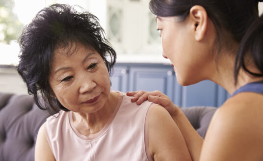 Senior woman and her daughter, starting the conversation about senior care options.