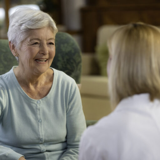 A geriatric care managers benefit seniors and their caregivers. Here, a senior woman speaks with her geriatric care manager.