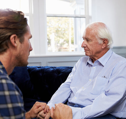 An adult male cares for his senior father, who suffers with dementia. Many caregivers struggle to manage the unpredictable behaviors of dementia.