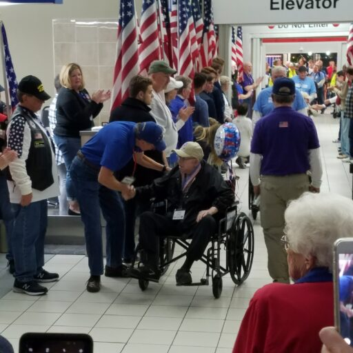 """Amos Wilson, Bethesda Hospice Care patient and resident at Bethesda Dilworth, as he was honored at the Greater St. Louis Honor Flight's """"Welcome Home"""" ceremony for Veterans."""