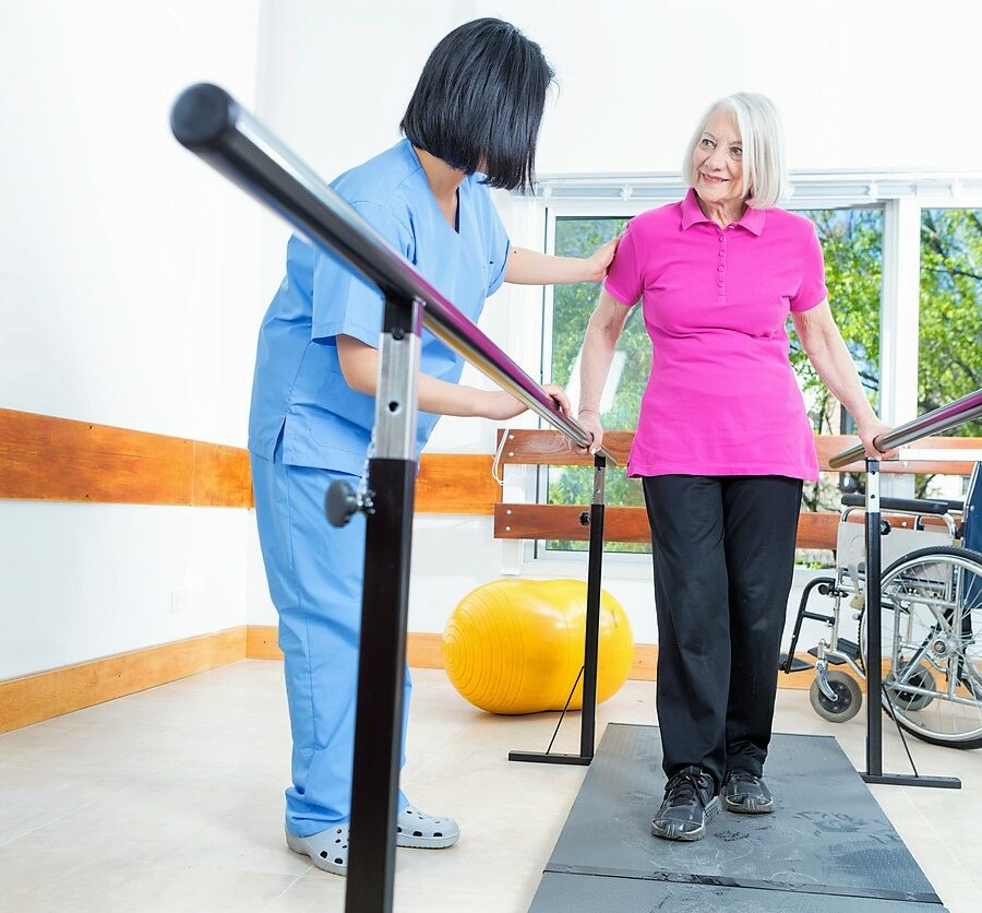 A senior woman during rehabilitation and physical therapy, which are vital to the senior healing process after an injury.