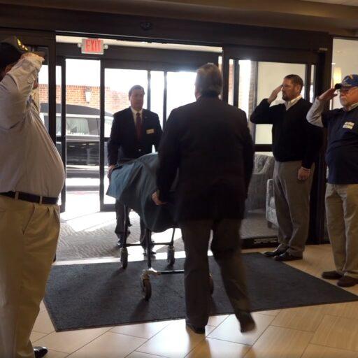 Residents saluting during Veteran Escort Ceremony
