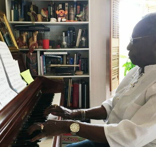 Seniors and Music make the perfect pair for promoting health and wellness, and here a senior woman plays her piano at home.