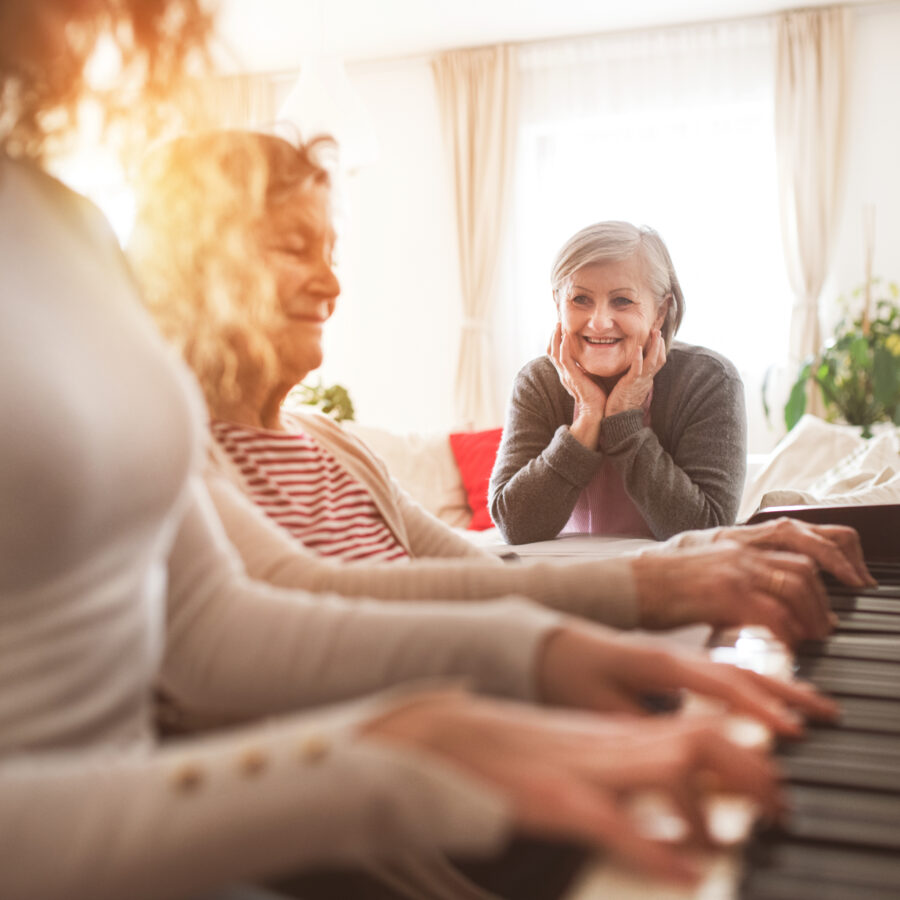 A senior woman explores music therapy for seniors. Music therapy benefits a seniors' mental, physical, and emotional health. Learn more about the Bethesda's music therapy program for seniors.