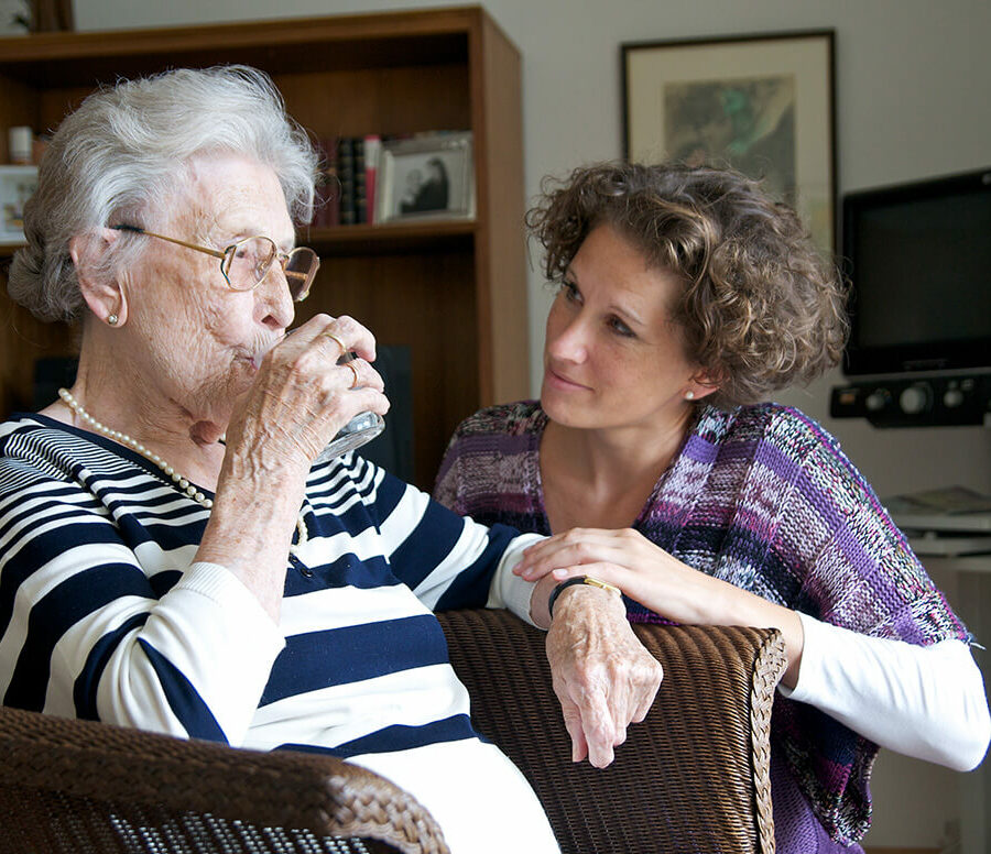 Caring for someone with dementia is a challenge, but it is also rewarding. Here, a daughter cares for her aging mother.