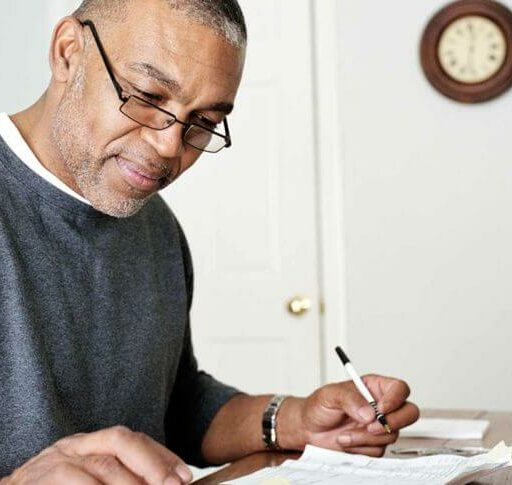A man sets his budget for retirement.