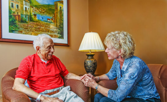 Volunteering at a senior care facility brings joy to seniors and volunteers. Here, a Bethesda volunteer comforts a senior resident.