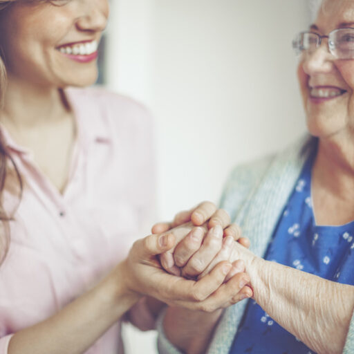 A friendly interaction between a senior woman and a woman who works in senior care. A career in senior care is rewarding because you are able to help others and form meaningful relationships, like the one found in this picture.