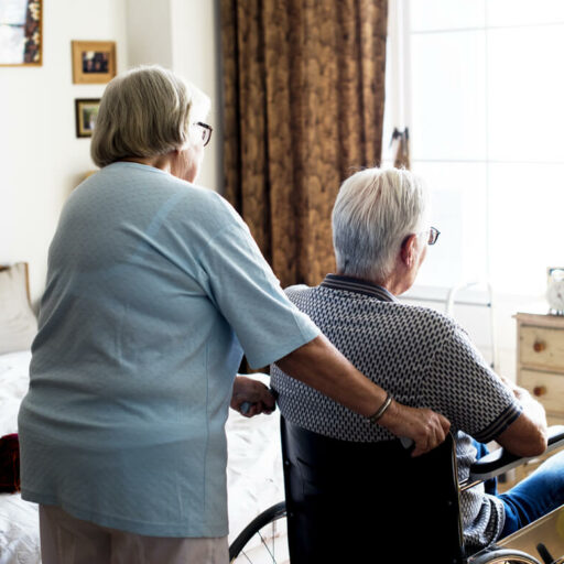 A senior couple, as the wife provides care for her husband. As the challenge of caregiving becomes more difficult and as your spouse's condition worsens, it may be time to find long-term care.