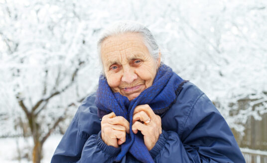 A senior woman is preparing for winter