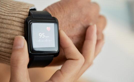A senior wears an Apple watch to prevent heart disease