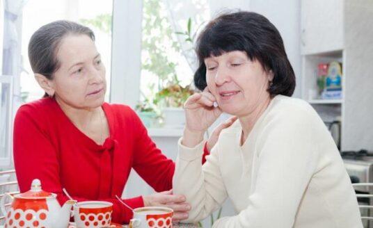 Two senior women discuss a dementia diagnosis