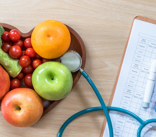 A plate of fruits, vegetables, and medical tests to help seniors manage diabetes