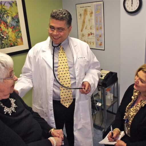 A senior woman gets checked out by a doctor with the benefits of a care manager