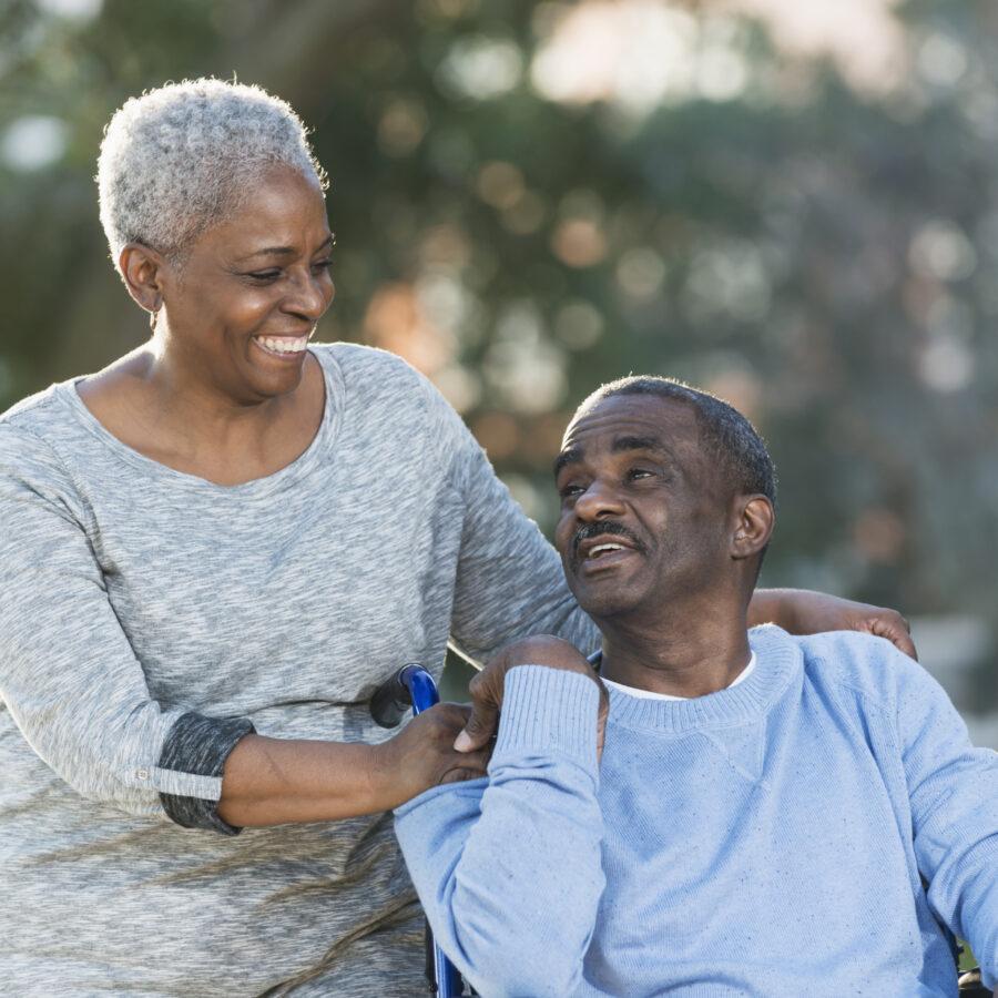 Senior caregiving is no easy task. Here, a senior woman cares for her senior husband.