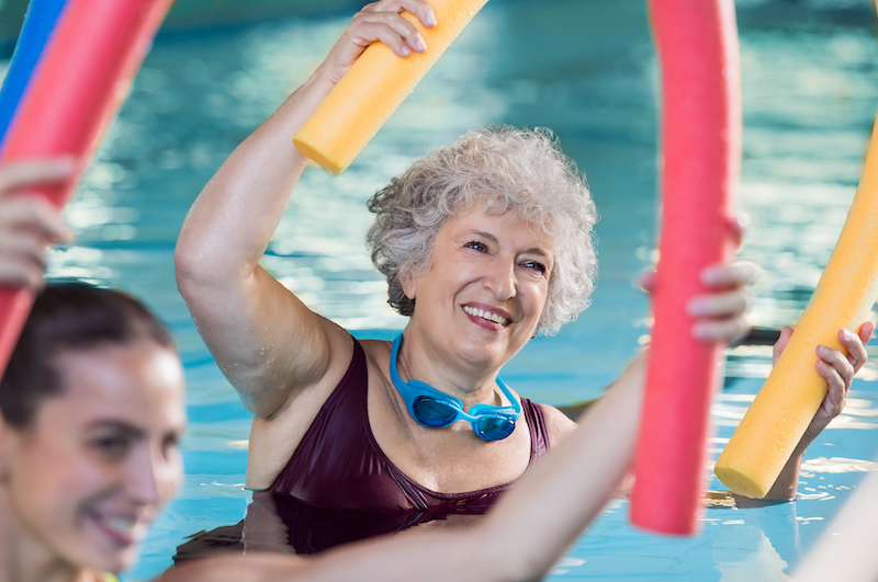 A woman participating in water aerobics for seniors