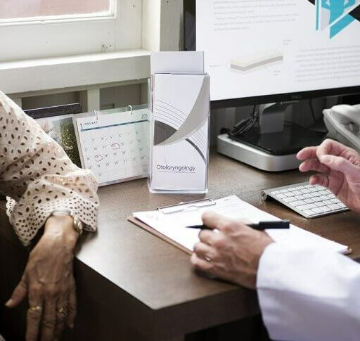 By learning how to effectively communicate with your doctor, you can improve your overall health. Here, an older woman talks with her doctor.