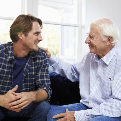 An adult man has a pleasant conversation with his father, who is living with Alzheimer's.