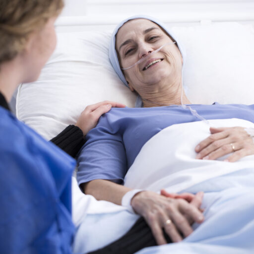 A woman talks to her loved one in hospice care.