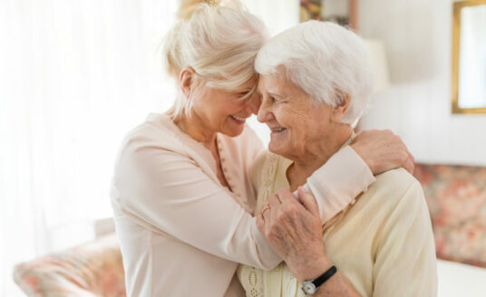 A woman has fun caregiving for her senior mother.