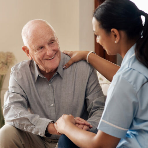 A senior man chats with a nurse, one of the many people you will meet at an assisted living community.