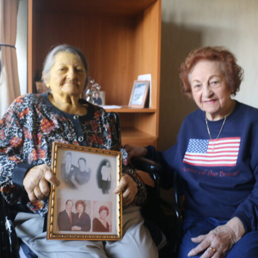 Dena Marmigas, a hospice care resident at Bethesda Dilworth, sits with her sister Mary, as they celebrate their heritage.