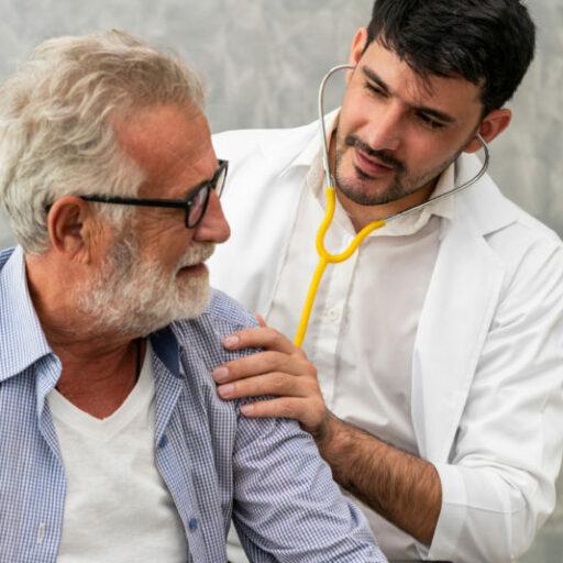 Doctor administering exam to prevent pneumonia in an elderly patient.
