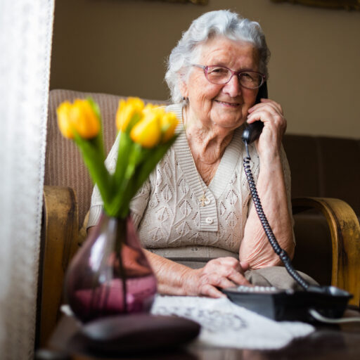 Senior woman staying connected in order to avoid feeling isolated