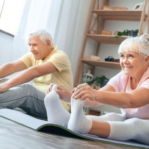 seniors performing restorative yoga