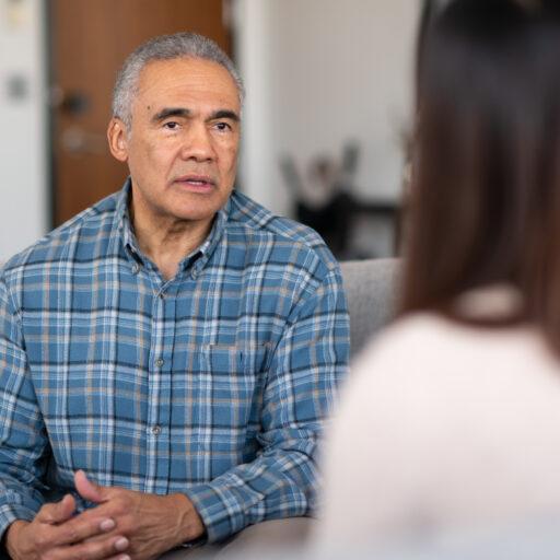 Lady talking to elderly man about sensitive topics