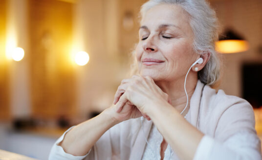 Senior woman shows how music can help with mental health