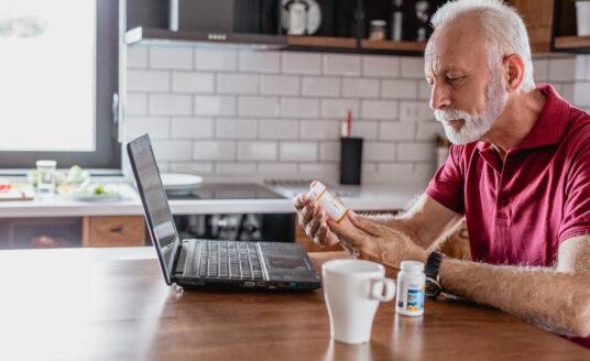 A senior man reviews medication management opportunities.