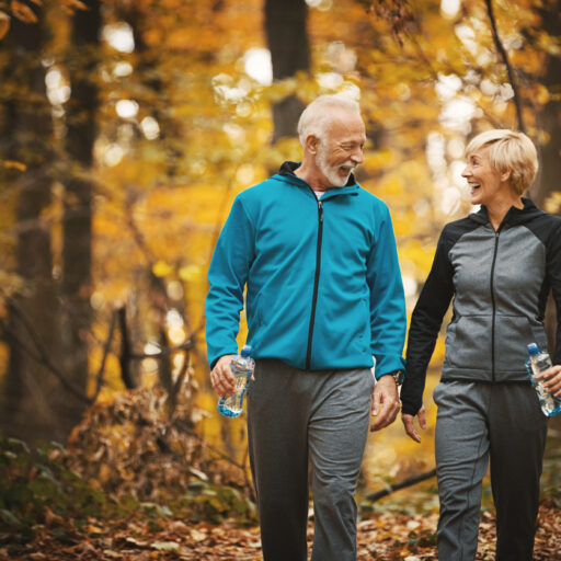 Senior couple walking as a healthy living tip during the fall season.