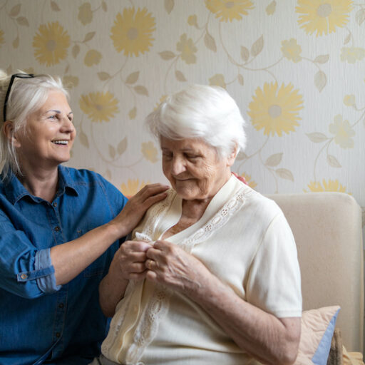 An older woman works with her senior mother to create a dementia care plan