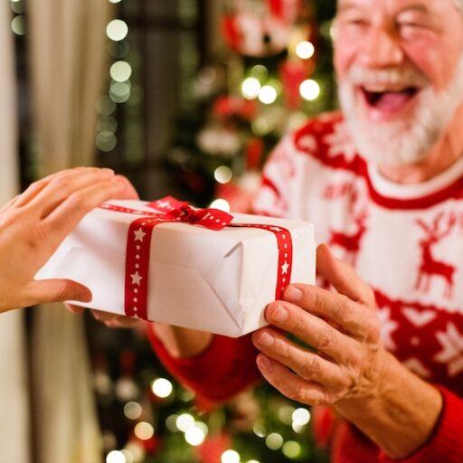 A senior man receives a holiday gift
