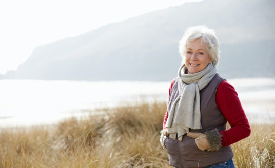 A senior woman focuses on winter health by getting outside on a nice winter day.