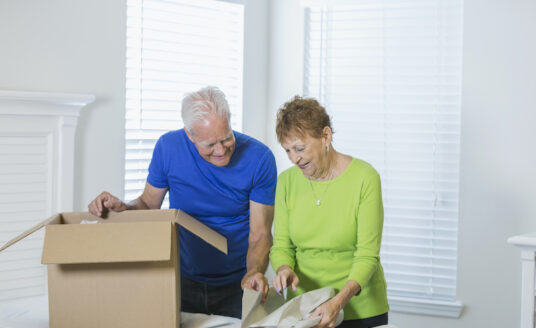A senior couple packs up their home as they prepare for moving to an Independent Living Community.