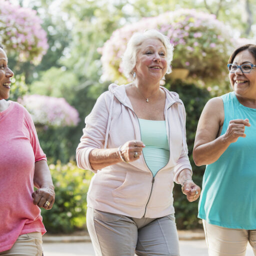 Multi-ethnic senior women walking together for the benefit of their health.