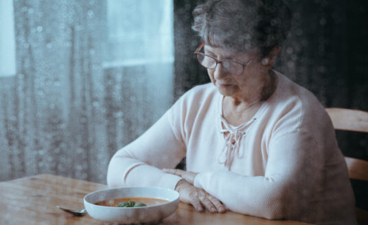 Senior woman having lack of appetite