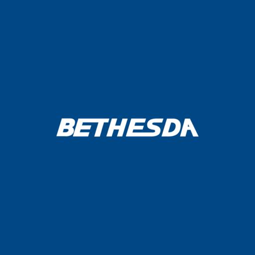 white Bethesda logo over a dark blue background