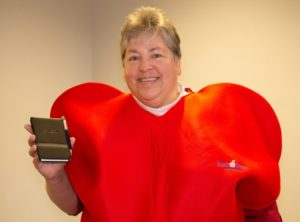An older woman in a red heart costume