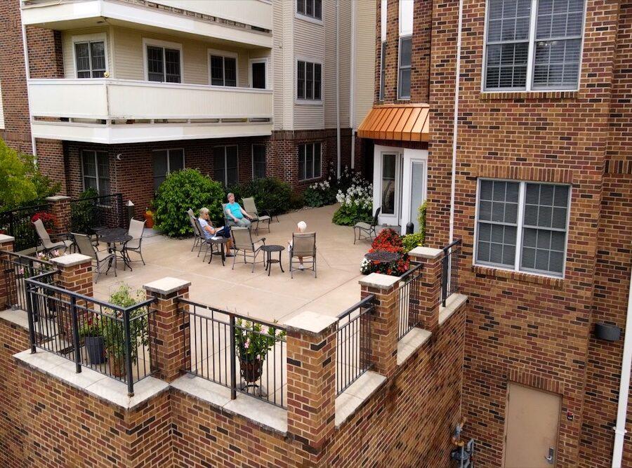 two seniors enjoy an enclosed patio at Bethesda Gardens