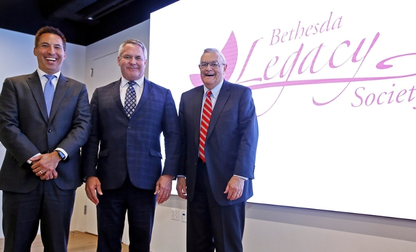Three older men in suits represent the Bethesda Legacy Society