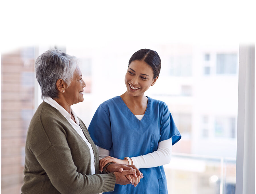 Young female nurse comforts senior woman with a hand on her arm
