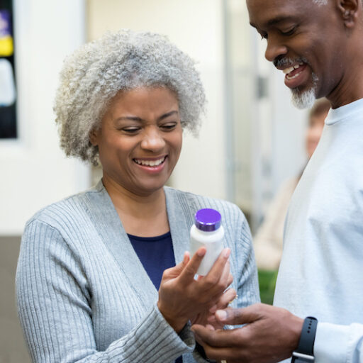 Older woman picking up important vitamins for senior health