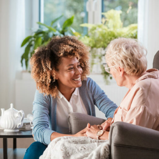 A senior woman chats with her nurse in her apartment at the skilled nursing home.