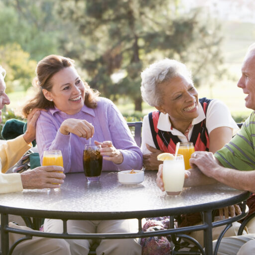Group of senior friends at a retirement community. Studies have shown that seniors live longer at retirement communities - and they are happier too!